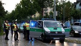 Police secure a street near to the scene of a shooting in Munich, Germany July 22, 2016.  REUTERS/Michael Dalder - RTSJ8SV