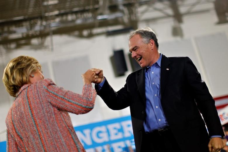 Democratic U.S. presidential candidate Hillary Clinton and U.S. Senator Tim Kaine (D-VA) react during a campaign rally at Ernst Community Cultural Center in Annandale, Virginia, U.S., July 14, 2016.  REUTERS/Carlos Barria - RTSHZ00