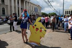 "Cosplayer dressed as a character of the augmented reality mobile game ""Pokemon Go"" by Nintendo participate in a ""poketour"" organized by the municipality in San Salvador, El Salvador July 23, 2016. REUTERS/Jose Cabezas"