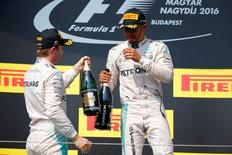 Hungary Formula One - F1 - Hungarian Grand Prix 2016 - Hungaroring, Hungary - 24/7/16 Mercedes' Lewis Hamilton and Nico Rosberg celebrate after the race  REUTERS/Laszlo Balogh
