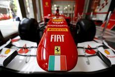 Ferrari and Fiat logos and a Italian flag are pictured on a replica of a Ferrari Formula One car in Santiago city, Chile, October 20, 2015.  REUTERS/Ivan Alvarado