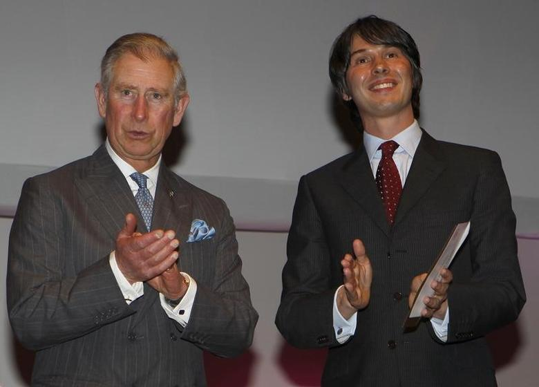 Britain's Prince Charles (L) and British particle physicist Brian Cox applaud during the Prince's Trust Celebrate Success Awards at the Odeon Leicester Square, in central London March 23, 2011.  REUTERS/Suzanne Plunkett