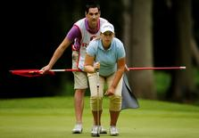 Britain Golf - RICOH Women's British Open 2016 - Woburn Golf & Country Club, England - 29/7/16 England's Liz Young with her caddie, husband Jonathan Young during the second round Action Images via Reuters / Andrew Couldridge Livepic