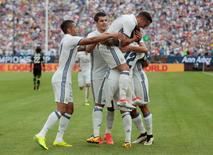 Football Soccer - Real Madrid v Chelsea - International Champions Cup - Michigan Stadium, Ann Arbor, United States of America - 30/7/16 Marcelo celebrates with team mates after scoring a goal for Real Madrid Action Images via Reuters / Rebecca Cook Livepic
