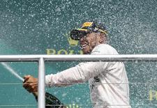 Germany Formula One - F1 - German Grand Prix 2016 - Hockenheimring, Germany - 31/7/16 - Mercedes' Lewis Hamilton sprays champagne after the race. REUTERS/Ralph Orlowski