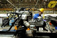 An employee works on an assembly line producing automobiles at a factory in Qingdao, Shandong Province, China, March 1, 2016.   REUTERS/Stringer/File Photo