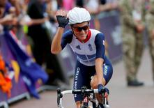 Britain's Elizabeth Armitstead waves before the women's cycling road race final at the London 2012 Olympic Games July 29, 2012. REUTERS/Cathal McNaughton/Files