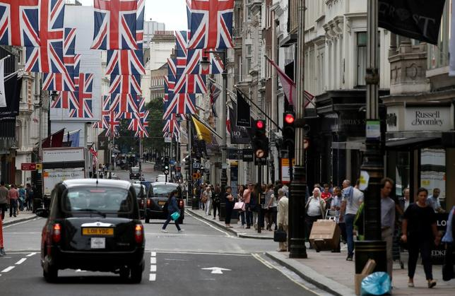 Shoppers walk past stores on New Bond Street in London, Britain July 9, 2016.  REUTERS/Peter Nicholls/File Photo