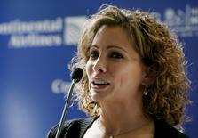 Olympic gymnast Shannon Miller talks about running the New York City Marathon at a news conference in New York November 3, 2006. REUTERS/Jeff Zelevansky
