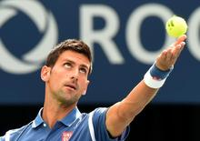Jul 31, 2016; Toronto, Ontario, Canada;  Novak Djokovic of Serbia serves to Kei Nishikori of Japan in the mens final on day seven of the Rogers Cup tennis tournament at Aviva Centre. Mandatory Credit: Dan Hamilton-USA TODAY Sports