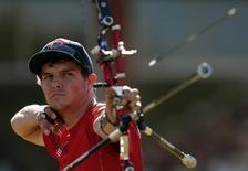 Jake Kaminski of the U.S. shoots during the men's archery individual round of 32 eliminations at the London 2012 Olympic Games at the Lord's Cricket Ground August 1, 2012. REUTERS/Suzanne Plunkett