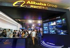 People visit the booth of Alibaba Group during an exhibition in Beijing, China, September 22, 2015.  REUTERS/Stringer
