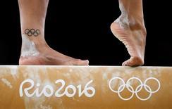 2016 Rio Olympics - Gymnastics training - Rio Olympic Arena - Rio de Janeiro, Brazil - 04/08/2016. Close up of the feet of Rebecca Downie (GBR) of United Kingdom as she trains on the beam.  REUTERS/Dylan Martinez