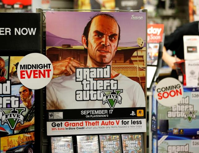 A promotion for the computer game ''Grand Theft Auto Five'' is show in a Game Stop gaming story in Encinitas, California September 17, 2013.  REUTERS/Mike Blake