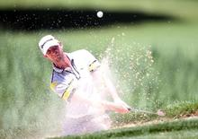 Jun 30, 2016; Akron, OH, USA;  Vaughn Taylor of the United States hits out of a bunker on the fifth hole at Firestone Country Club - South Course. Mandatory Credit: Charles LeClaire-USA TODAY Sports - RTX2J56U