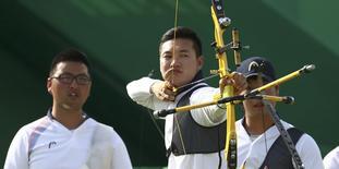 2016 Rio Olympics - Archery - Quarterfinal - Men's Team Quarterfinal - Sambodromo - Rio de Janeiro, Brazil - 06/08/2016. Ku Bon-Chan (KOR) of South Korea competes.  REUTERS/Yves Herman