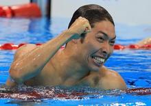 2016 Rio Olympics - Swimming - Final - Men's 400m Individual Medley Final - Olympic Aquatics Stadium - Rio de Janeiro, Brazil - 06/08/2016. Kosuke Hagino (JPN) of Japan celebrates winning the gold medal. REUTERS/Dominic Ebenbichler