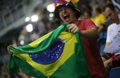 2016 Rio Olympics - Swimming - Preliminary - Heats - Olympic Aquatics Stadium - Rio de Janeiro, Brazil - 06/08/2016. A fan waves a Brazil flag to cheer on the team. REUTERS/Marcos