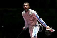 2016 Rio Olympics - Fencing - Final - Men's Foil Individual Gold Medal Bout - Carioca Arena 3 - Rio de Janeiro, Brazil - 07/08/2016. Daniele Garozzo (ITA) of Italy celebrates winning his match. REUTERS/Issei Kato