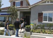 """Prospective home owners tour an Express home in a  community called """"The Quarry"""" which is being developed by builder D.R. Horton in Jurupa Valley, California, U.S. on July 23, 2016.  REUTERS/Nichola Groom"""