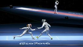 Eleanor Harvey (CAN) of Canada competes with Arianna Errigo (ITA) of Italy. REUTERS/Peter Cziborra