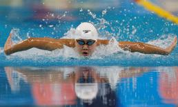 Gold medallist Chen Xinyi of China competes to win the women's 100m butterfly final swimming competition at the Munhak Park Tae-hwan Aquatics Center during the 17th Asian Games in Incheon September 23, 2014. REUTERS/Tim Wimborne