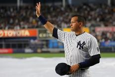 New York Yankees designated hitter Alex Rodriguez acknowledges the crowd before his last game as a Yankee against the Tampa Bay Rays at Yankee Stadium.  Anthony Gruppuso-USA TODAY Sports