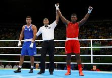 2016 Rio Olympics - Boxing - Preliminary - Men's Super Heavy (+91kg) Round of 16 Bout 161 - Riocentro - Pavilion 6 - Rio de Janeiro, Brazil - 13/08/2016. Lenier Pero (CUB) of Cuba celebrates after winning his bout against Guido Vianello (ITA) of Italy. REUTERS/Peter Cziborra