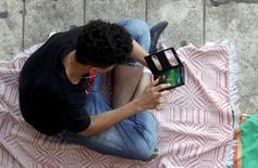 2016 Rio Olympics - Pokemon - Quinta da Boa Vista - Rio de Janeiro, Brazil - 13/08/2016. A boy plays Pokemon Go in an urban park in Rio de Janeiro. REUTERS/Ricardo Moraes