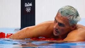 2016 Rio Olympics - Swimming - Final - Men's 200m Individual Medley Final - Olympic Aquatics Stadium - Rio de Janeiro, Brazil - 11/08/2016. Ryan Lochte (USA) of USA reacts. REUTERS/David Gray