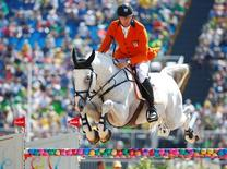 2016 Rio Olympics - Equestrian - Preliminary - Jumping Team Qualification - Olympic Equestrian Centre - Rio de Janeiro, Brazil - 14/08/2016. Jur Vrieling (NED) of Netherlands riding Zirocco Blue competes. REUTERS/Tony Gentile
