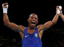 2016 Rio Olympics - Boxing - Semifinal - Men's Light (60kg) Semifinals Bout 181 - Riocentro - Pavilion 6 - Rio de Janeiro, Brazil - 14/08/2016. Robson Conceicao (BRA) of Brazil reacts after winning his bout. REUTERS/Peter Cziborra