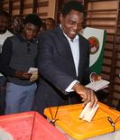 United Party for National Development (UPND) President candidate Hakainde Hichilema (R) and his son Habwela Hakainde cast their votes during the  presidential and parliamentary elections in the capital, Lusaka, Zambia, August 11, 2016. REUTERS/Jean Serge Mandela