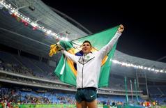 2016 Rio Olympics - Athletics - Final - Men's Pole Vault Final - Olympic Stadium - Rio de Janeiro, Brazil - 15/08/2016. Thiago Braz da Silva (BRA) of Brazil celebrates after winning the gold medal. REUTERS/Dominic Ebenbichler