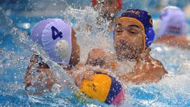 2016 Rio Olympics - Water Polo - Quarterfinal - Men's Quarterfinal Hungary v Montenegro - Olympic Aquatics Stadium - Rio de Janeiro, Brazil - 16/08/2016. Balazs Erdelyi (HUN) of Hungary and Drasko Brguljan (MNE) of Montenegro compete. REUTERS/Laszlo Balogh