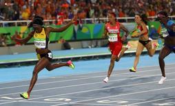 2016 Rio Olympics - Athletics - Final - Women's 200m Final - Olympic Stadium - Rio de Janeiro, Brazil - 17/08/2016. Elaine Thompson (JAM) of Jamaica competes on her way to winning the gold medal.  REUTERS/Kai Pfaffenbach