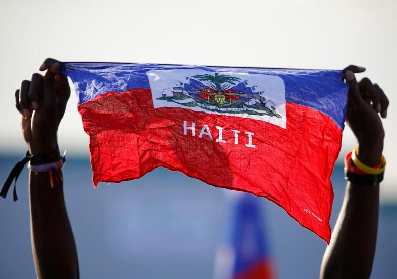 A girl holds national flag of Haiti before Pope Francis' arrival at the Campus Misericordiae during World Youth Day in Brzegi, near Krakow, Poland July 30, 2016. REUTERS/Stefano Rellandini