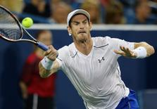 Aug 17, 2016; Mason, OH, USA; Andy Murray (GBR) returns a shot against Juan Monaco (ARG) on day five during the Western and Southern tennis tournament at Linder Family Tennis Center. Aaron Doster-USA TODAY Sports