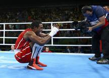 2016 Rio Olympics - Boxing - Final - Men's Middle (75kg) Final Bout 269 - Riocentro - Pavilion 6 - Rio de Janeiro, Brazil - 20/08/2016. Arlen Lopez Cardona (CUB) of Cuba celebrates after winning his bout. REUTERS/Peter Cziborra