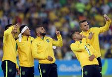 2016 Rio Olympics - Soccer - Victory Ceremony - Men's Football Tournament Victory Ceremony - Maracana - Rio de Janeiro, Brazil - 20/08/2016. Neymar (BRA) of Brazil and teammates pose for a selfie as they receive their gold medals.  REUTERS/Bruno Kelly