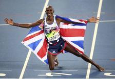 2016 Rio Olympics - Athletics - Final - Men's 5000m Final - Olympic Stadium - Rio de Janeiro, Brazil - 20/08/2016. Gold medalist Mo Farah (GBR) of Britain celebrates. REUTERS/Alessandro Bianchi