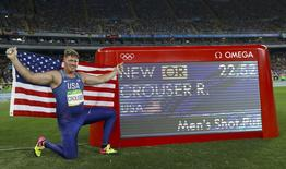2016 Rio Olympics - Athletics - Final - Men's Shot Put Final - Olympic Stadium - Rio de Janeiro, Brazil - 18/08/2016. Ryan Crouser (USA) of USA celebrates winning the gold medal and setting a new Olympic record.     REUTERS/Kai Pfaffenbach