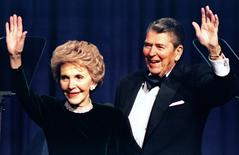 Former US President Ronald Reagan and his wife Nancy wave while attending a gala celebrating his 83rd birthday, in Washington February 3, 1994.  REUTERS/Mike Theiler