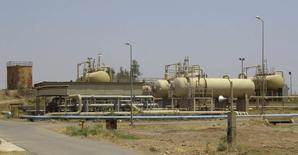 """Imagen del yacimiento petrolero Bai Hassan en el noroeste de Kirkuk. 12 de julio, 2014. Irak está dispuesto a """"desempeñar un papel"""" al interior de la Organización de Países Exportadores de Petróleo para apuntalar los precios del crudo, dijo el sábado el ministro iraquí de Energía Jabar Ali al-Luaibi en la ciudad sureña de Basora.  REUTERS/Ako Rasheed"""