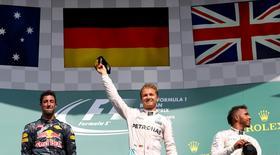 Belgium Formula One - F1 - Belgian Grand Prix 2016 - Francorchamps, Belgium - 28/8/16 - Mercedes' Nico Rosberg of Germany (C) celebrates on the podium with Mercedes' Lewis Hamilton of Britain (R) and Red Bull's Daniel Ricciardo of Australia (L) after the Belgian F1 Grand Prix.  REUTERS/Yves Herman