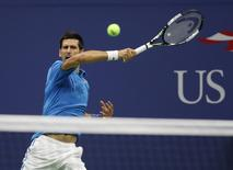 Aug 29, 2016; New York, NY, USA; Novak Djokovic of Serbia hits to Jerzy Janowicz of Poland on day one of the 2016 U.S. Open tennis tournament at USTA Billie Jean King National Tennis Center. Geoff Burke-USA TODAY Sports