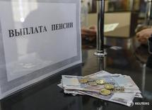 "A pension payment in Russian roubles is seen at a post office in the Crimean city of Simferopol March 25, 2014. Annexed by Russia, Crimea took the rouble as its official currency on Monday, but confusion over the exchange rate meant the hryvnia was still the main form of money changing hands. The sign reads as ""Pensions pay-off"". REUTERS/Shamil Zhumatov (UKRAINE - Tags: POLITICS CIVIL UNREST BUSINESS)"