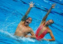 Christina Jones and Bill May of the U.S. perform in the synchronised swimming mixed duet technical final at the Aquatics World Championships in Kazan, Russia, July 26, 2015.         REUTERS/Michael Dalder