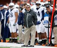 Penn State University head coach Joe Paterno looks toward the scoreboard during his team's game against the University of Illinois in their NCAA football game in Champaign, Illinois, U.S. in this file October 3, 2009 photo.  REUTERS/Jeff Haynes/File Photo