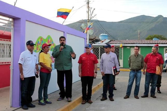 Venezuela's President Nicolas Maduro (3rd L) talks during an event to handover houses that have been restored in Margarita Island, Venezuela September 2, 2016. Miraflores Palace/Handout via REUTERS